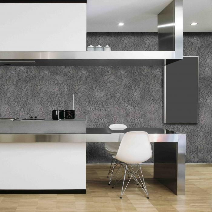cucina moderna con piano di acciaio e parquet
